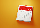 Post it May 2019 calendar on yellow background. Horizontal composition with copy space. Calendar and reminder concept.