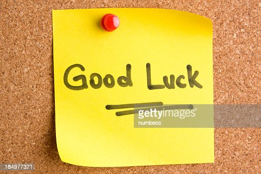 A post it note saying Good Luck with a red pin