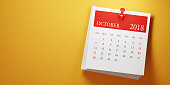 Post it October calendar on yellow background. Panoramic composition with copy space. Calendar and reminder concept.