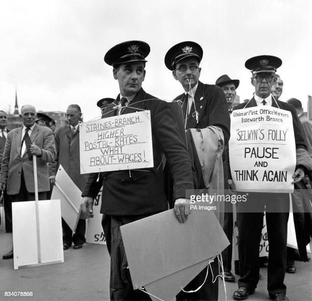 Post Office workers are seen with placards near the Post Office headquarters in St Martin'sleGrand when a marching file of Post Office employees...