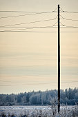 post pole pillar transmission facilities in winter sunset
