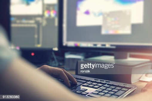 post production - man doing photo and video editing on computer : Stock Photo