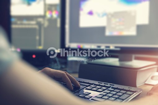 post production - man doing photo and video editing on computer : Foto de stock