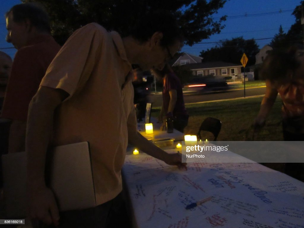 Post Rally Peace and Unity sign, attendees sign and leave messages during a Rally for Unity and Peace with Mayor, Councilwoman, full Borough Council and religious leaders in Fair Lawn, NJ on August 20, 2017.