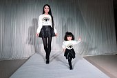 A Post90s generation mother hosts a fashion show with her twoyearold daughter on April 23 2015 in Taiyuan Shanxi province of China The dress show was...