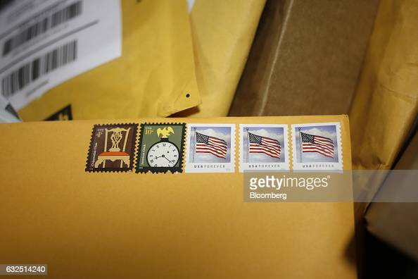 Postage stamps are seen on an envelope inside the United States Postal Service sorting center in Louisville Kentucky US on Friday Jan 13 2017...