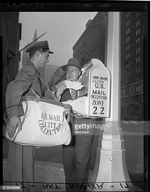 Postal Carrier and Postmaster collect mail from a newly designed light pole and matching letter box on Park Avenue and 50th Street in New York city