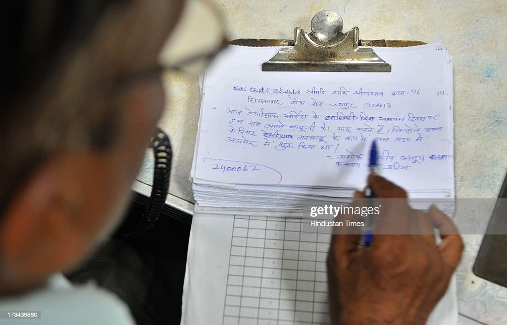 A postal department official notes down a PHONOGRAM booked by a family because their grandfather started his career as telegraph official in 1950, at General Post Office on July 14, 2013 in Jaipur, India. The work to lay telegraph lines started in 1850 on an experimental basis between Koklata and Diamond Harbour, it was opened for use by the British East India Company the following year. In 1854, the service was made available to the public. 163-year-old telegram service is being shut down by the Government from 15th of July, across the country.