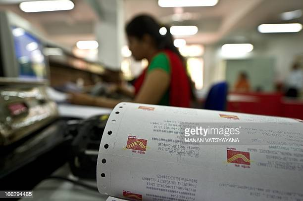Postal receipts are seen as an attendant works at the newly inaugrated 'All women employees post office' in New Delhi on April 11 2013 The post...