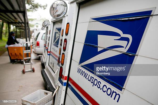 US Postal Service delivery trucks sit at the Brookland Post Office in Washington DC US on Thursday May 9 2013 The USPS is projecting a loss of as...