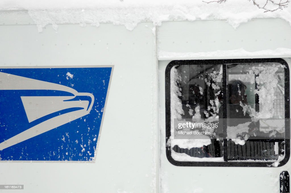 S. Postal Service employee drives a truck covered with snow following a major winter storm on February 9, 2013 in Hoboken, New Jersey. Much of the Northeast received a foot or more of snow through Saturday morning with possible record-setting blizzard conditions expected. Heavy snow warnings are in effect from New Jersey through southern Maine.