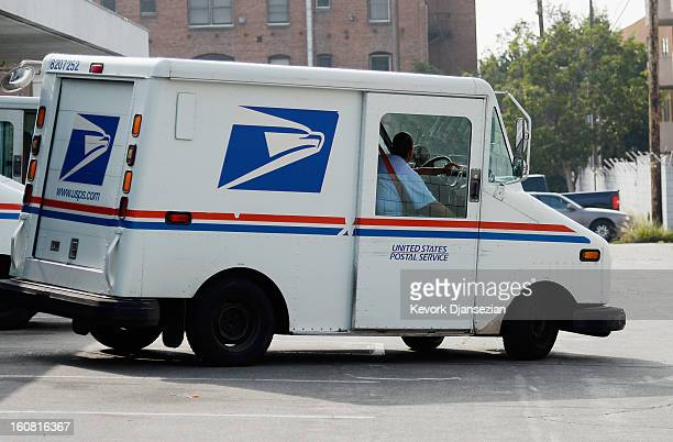 S Postal service employee leaves the loading dock to deliver mail from the Los Feliz Post Office on February 6 2013 in Los Angeles California The US...