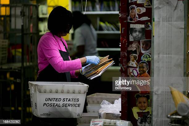 US Postal Service employee Terrie Williams sorts mail before delivery at the Brookland Post Office in Washington DC US on Thursday May 9 2013 The...