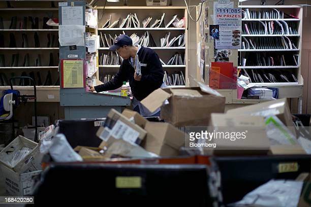 US Postal Service letter carrier Anja Wilson prepares mail for delivery at the Brookland Post Office in Washington DC US on Thursday May 9 2013 The...