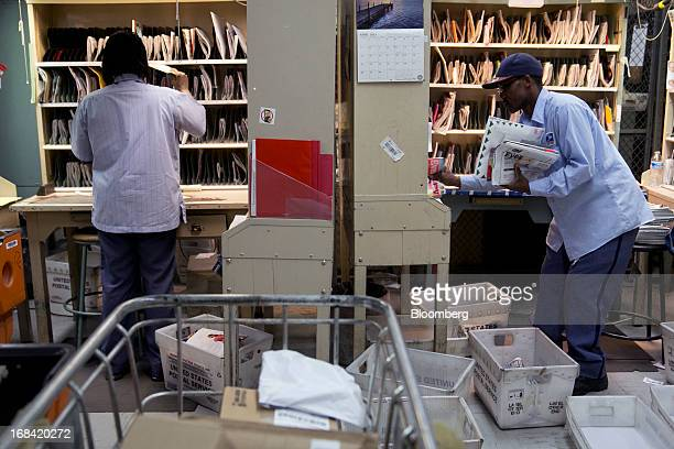 US Postal Service letter carriers prepare mail for delivery at the Brookland Post Office in Washington DC US on Thursday May 9 2013 The USPS is...