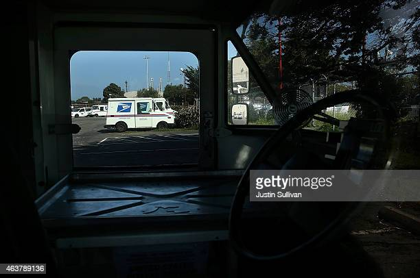 S Postal Service mail delivery vehicles sit in a parking lot at a mail distribution center on February 18 2015 in San Francisco California The Postal...