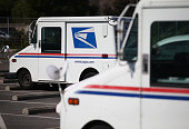 S Postal Service mail vehicles sit in a parking lot at a mail distribution center on February 18 2015 in San Francisco California The Postal Service...