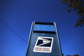 S Postal Service mailbox stands on November 15 2012 in Miami Florida The United States Postal Service reported a record annual yearly loss of $159...