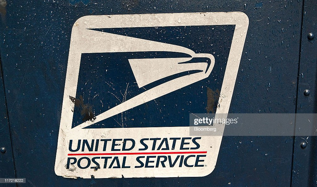 U. S. Postal Service signage is displayed on a mailbox in New York, U.S., on Thursday, June 23, 2011. The U.S. Postal Service, facing insolvency without approval to delay a $5.5 billion payment for worker health benefits, will suspend contributions to an employee retirement account to save $800 million this year. Photographer: Timothy Fadek/Bloomberg via Getty Images