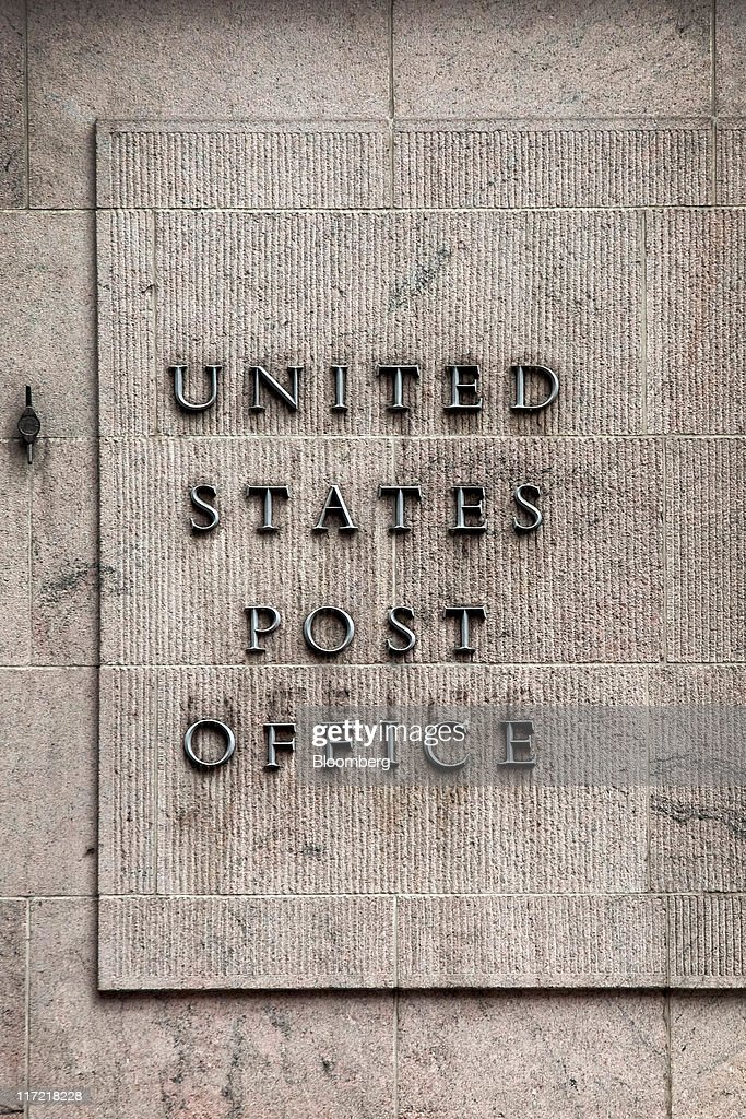 U. S. Postal Service signage is displayed on the exterior of Grand Central Station in New York, U.S., on Thursday, June 23, 2011. The U.S. Postal Service, facing insolvency without approval to delay a $5.5 billion payment for worker health benefits, will suspend contributions to an employee retirement account to save $800 million this year. Photographer: Timothy Fadek/Bloomberg via Getty Images