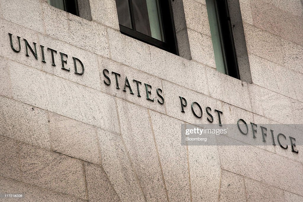 U. S. Postal Service signage is displayed on the exterior of the James A. Farley post office building in New York, U.S., on Thursday, June 23, 2011. The U.S. Postal Service, facing insolvency without approval to delay a $5.5 billion payment for worker health benefits, will suspend contributions to an employee retirement account to save $800 million this year. Photographer: Timothy Fadek/Bloomberg via Getty Images