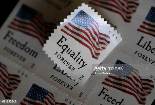 S Postal Service stamps are displayed on May 10 2017 in San Anselmo California The US Postal Service is seeking to raise the price of stamps by a...