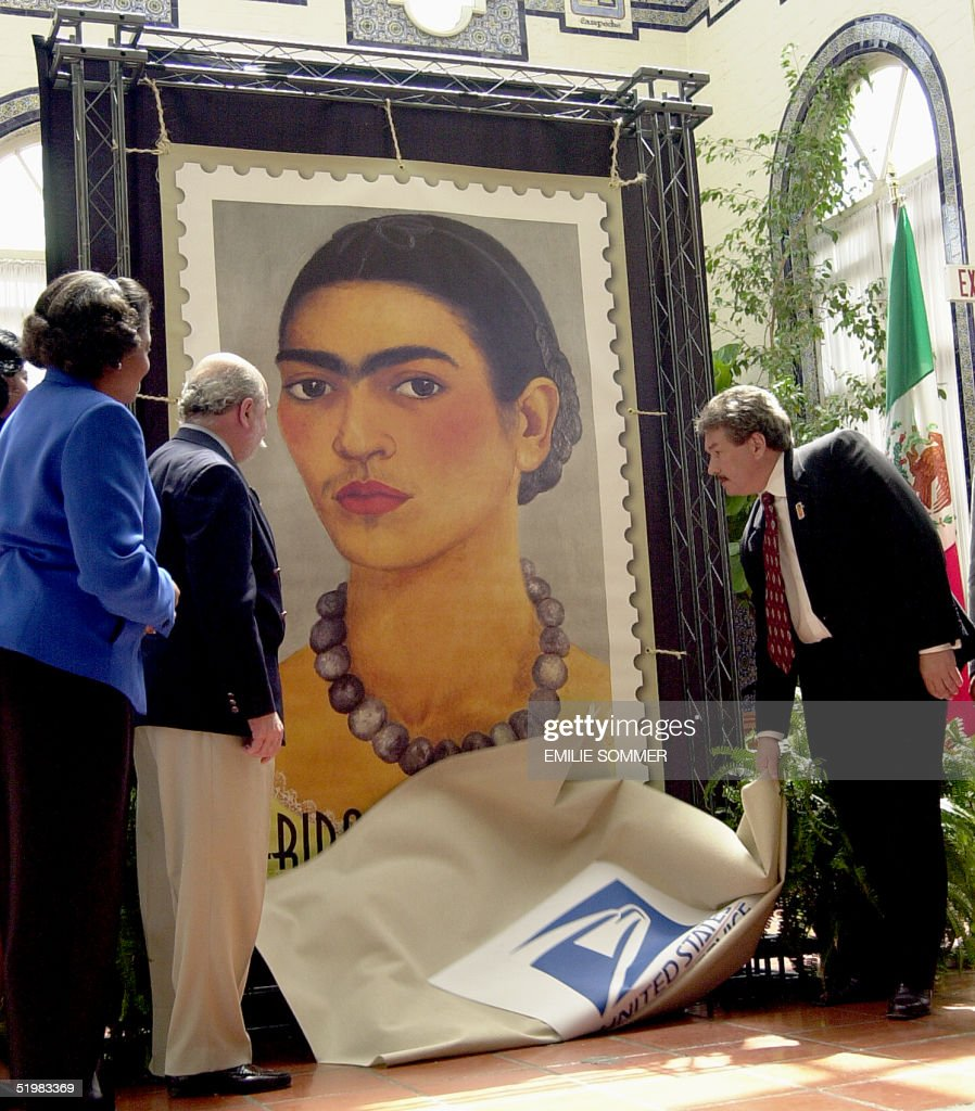 US Postal Service Vice President of Diversity Benjamin P. Ocasio, (R), unveils the Frida Kahlo commemorative stamp at a ceremony at the Mexican Cultural Institute in Washington, DC, 12 July 2001. Kahlo had a positive influence on the female Mexican-American population and is the first Hispanic woman to be featured on a US postage stamp.