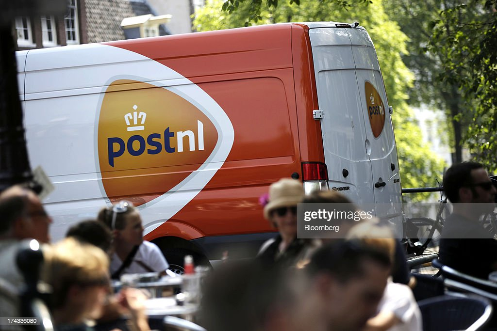 A postal van operated by PostNL NV passes customers sitting on an outdoor cafe terrace in Amsterdam, Netherlands, on Tuesday, July 23, 2013. Dutch pension funds will be allowed to calculate liabilities on the basis of an adjusted discount rate as the government seeks to keep the retirement system viable amid low interest rates and an aging population. Photographer: Matthew Lloyd/Bloomberg via Getty Images