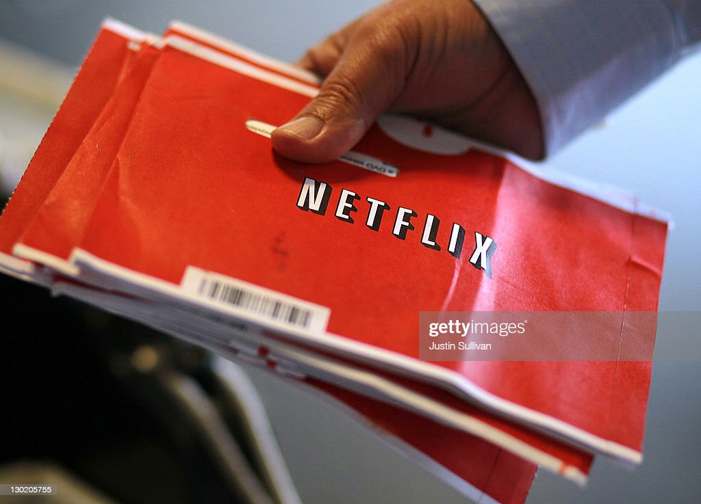 S. Postal worker holds a stack of Netflix envelopes at the U.S. Post Office sort facility on October 24, 2011 in San Francisco, California. Online movie rental company Netflix reported third quarter earnings of $62.5 million, or $1.16, per share compared to $38 million, or 70 cents per share one year ago.