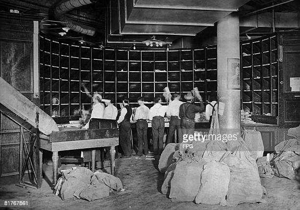 Postal workers at a sorting office for secondclass mail in New York circa 1920