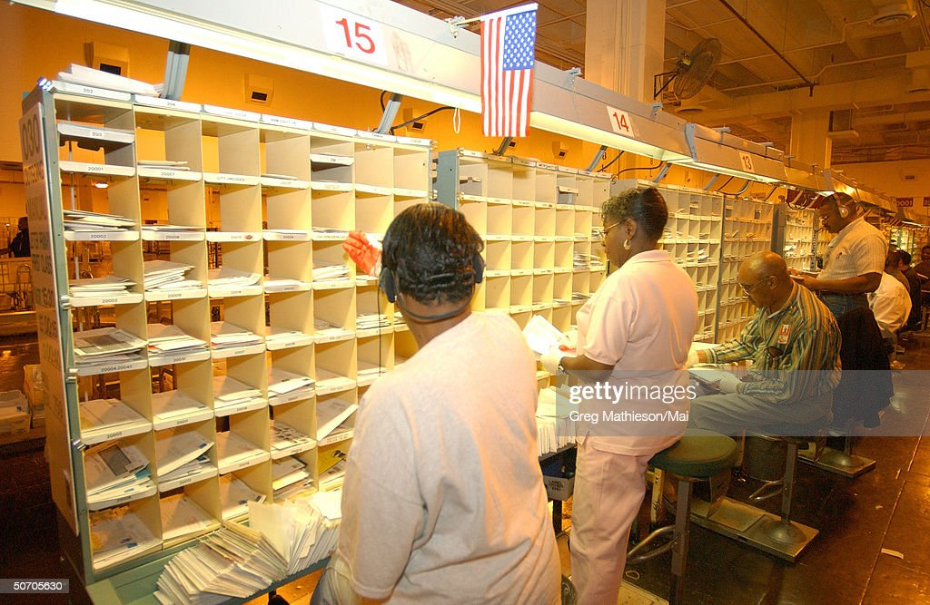 US Postal workers at the Brentwood office sorting mail designated for Washington, DC. This is the office where two employees contracted Anthrax and later died from the disease.
