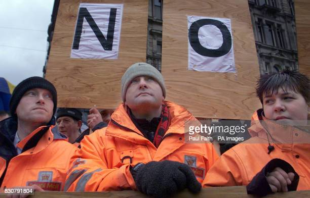 Postal workers take to the streets to protest over the murder of postman Daniel McColgan at a trade union rally in Belfast Friday January 18 2002...
