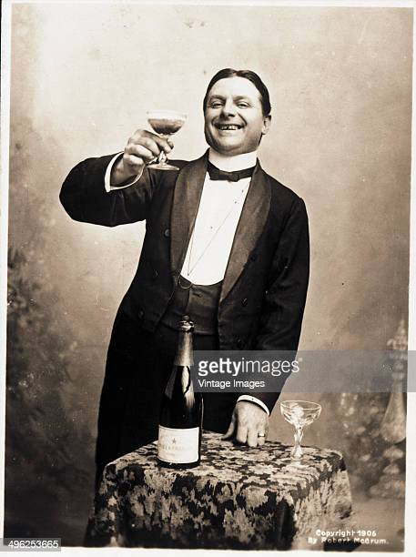 Postcard depicts a man as he grins and raises a toast with a glass of champagne 1906 His smile shows a missing front tooth and several others that...