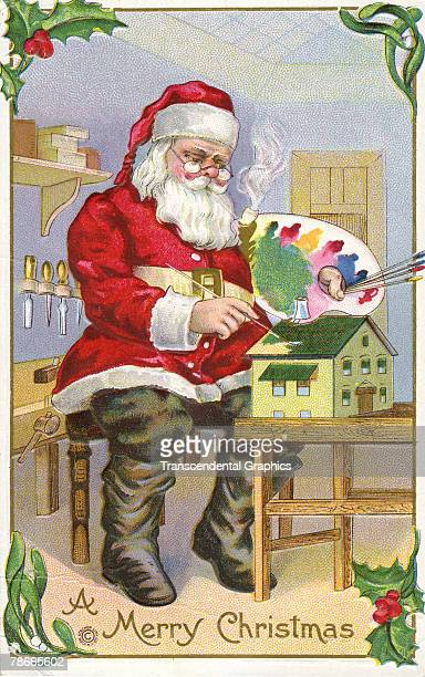 Postcard depicts a merry Santa Claus figure as he paints the roof of a doll house using paint from a palette 1910 The image was printed by the...