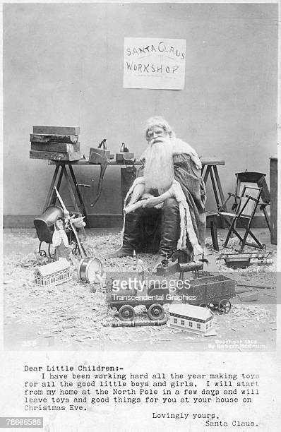 Postcard features a photograph of a Santa Claus figure seated among toys under a sign which reads 'Santa Claus Workshop' 1906 There is a typewritten...