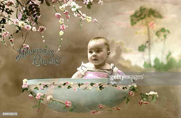 Postcard for Easter representing a baby in a shell of egg dating of the beginning of the century