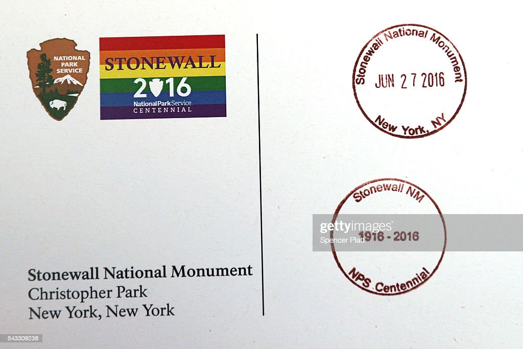 A postcard handed out by employees of the National Park Service with stamps commemorating the Stonewall Inn as a national monument at a dedication ceremony officially designating the Stonewall Inn as a national monument to gay rights on June 27, 2016 in New York City. Elected and federal officials joined members of the LGBT community at the dedication ceremony of the historic bar that has played a pivotal role in the battle for the rights of people in the gay community. White House Senior Advisor Valerie Jarrett, Director of the National Park Service Jonathan Jarvis, Mayor Bill de Blasio and others were all on hand for the afternoon ceremony.