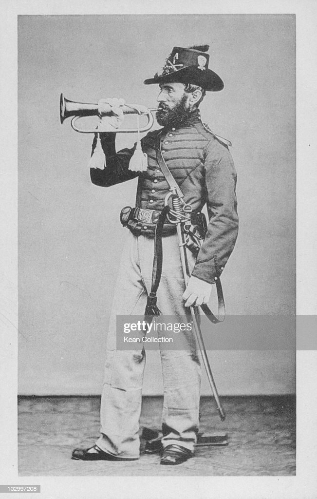 A postcard of a musician of the US Army Calvary during the US civil war playing a bugle and carrying a sword circa 1861