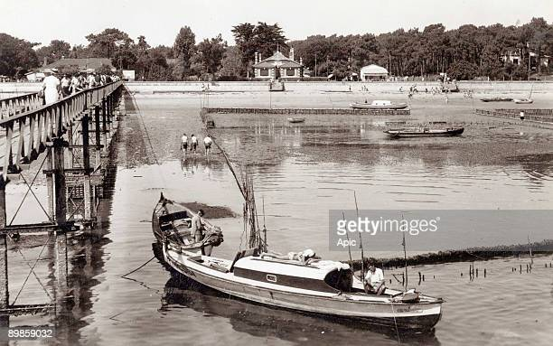 Postcard of Cap Ferret The pier and the beach Le CapFerret is located at the southern tip of the peninsula of LegeCapFerret in the Gironde between...