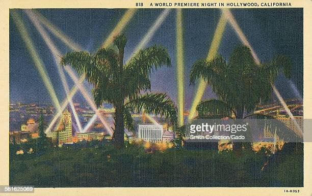 Postcard of searchlights and palm trees during the world premiere of a movie Hollywood California 1943