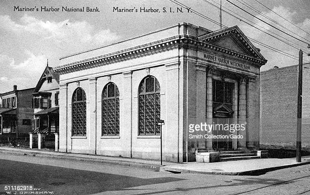 Postcard picture of the Mariner's Harbor National Bank a corner view showing the right side wall with three big window and the facade of the...