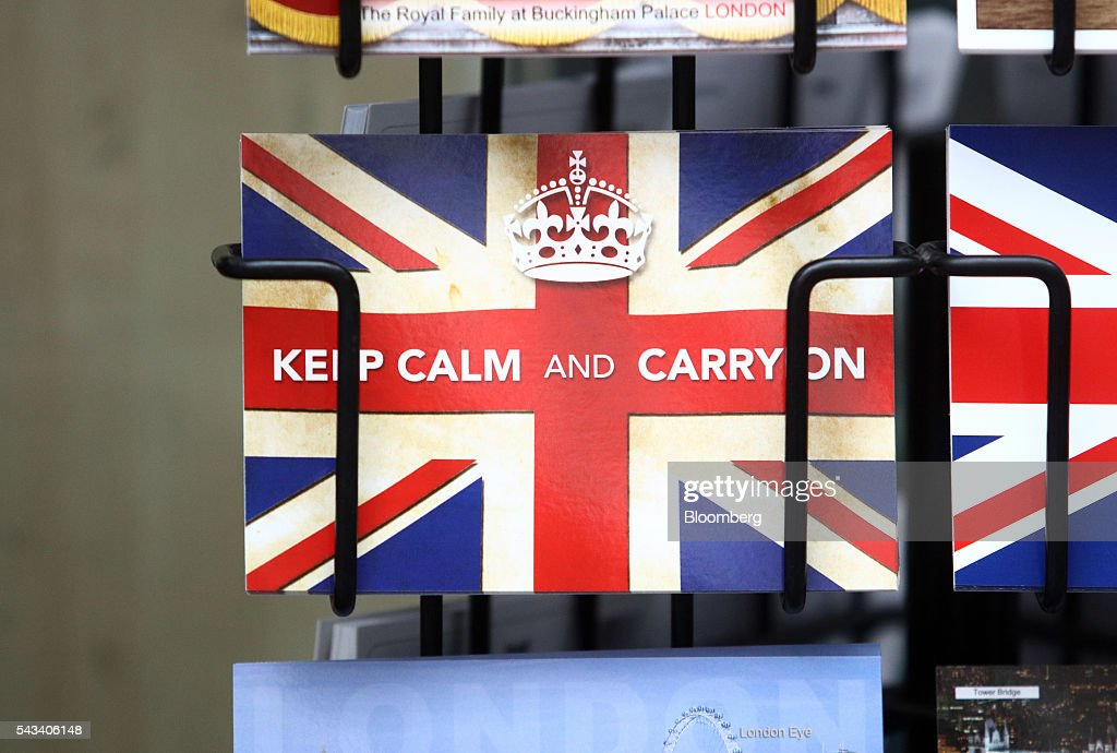 A postcard reading 'Keep Calm and Carry On' sits in a rack outside a newsagent in London, U.K., on Tuesday, June 28, 2016. The pound rose for the first time since the U.K.s vote to leave the European Union, as a recovery in investor appetite for higher-yielding assets seeped through currency markets. Photographer: Chris Ratcliffe/Bloomberg via Getty Images