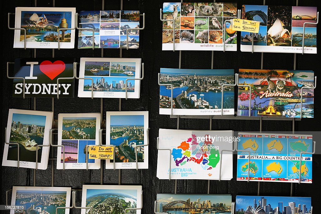 Postcards are displayed for sale at a store in the Rocks area in Sydney, Australia, on Monday, Dec. 24, 2012. At least 150,000 people from mainland China and across Asia are projected to descend on Sydney, Australia's most populous city, during the New Year's Eve and Chinese New Year period. Photographer: Brendon Thorne/Bloomberg via Getty Images
