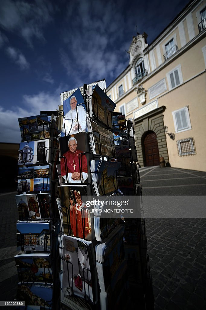 Postcards are displayed on February 20, 2013 outside a souvenirs shop on the main square of Castel Gandolfo, Italy. Pope Benedict XVI will stay at the Vatican's summer residence from February 28 until the convent of Mater Ecclesiae (Mother of the Church) at the Vatican will be ready to host him. Pope Benedict XVI began a week-long spiritual retreat out of the public eye on February 18 ahead of his resignation on February 28 with the field of candidates to succeed him still wide open.