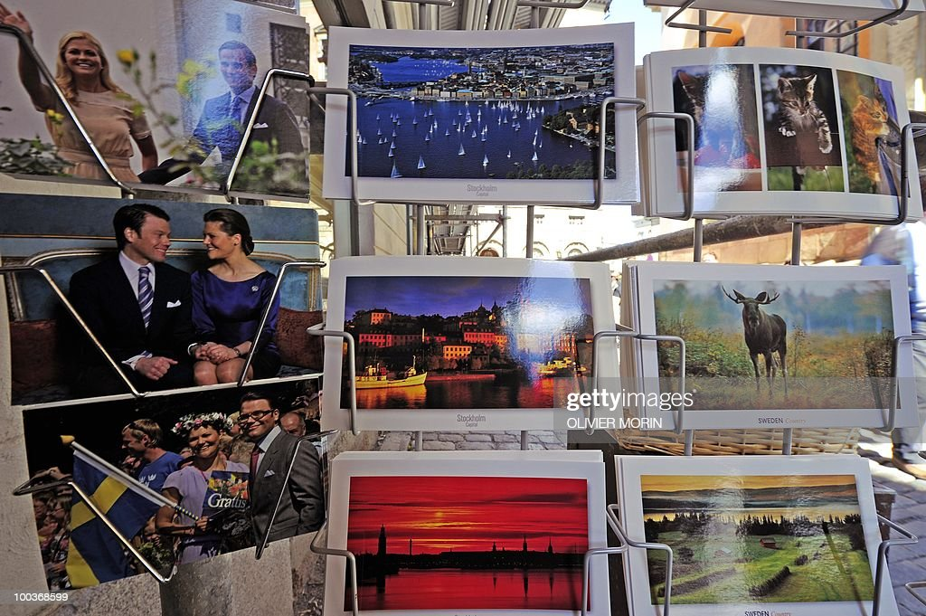 Postcards featuring Swedish crown Princess Victoria and her fiance Daniel Westling (L/C) are for sale on a rack in a souvenir shop near the Royal Castle in Stockholm on May 24, 2010, where the royal wedding will be held. Many tourists paid a visit to the Swedish capital less than a month before Crown Princess Victoria 's wedding, the 32-year-old eldest daughter of King Carl XVI Gustaf.