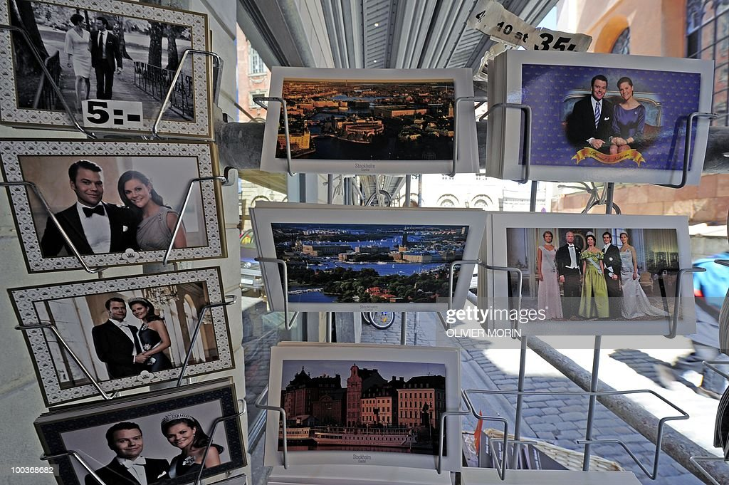 Postcards (L) of Swedish crown Princess Victoria and her fiance Daniel Westling are displayed on a rack for sale in a souvenir shop near the Royal Castle in Stockholm on May 24, 2010, where the royal wedding will be held. Many tourists paid a visit to the Swedish capital less than a month before Crown Princess Victoria 's wedding, the 32-year-old eldest daughter of King Carl XVI Gustaf.