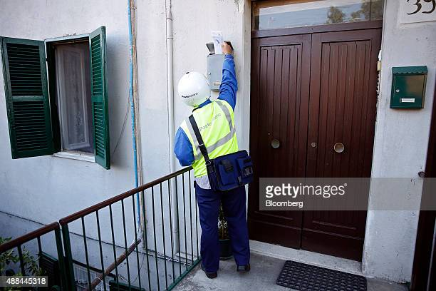 A Poste Italiane SpA postman delivers mail in Rome Italy on Thursday Sept 10 2015 Italy is proceeding with a plan to sell as much as 40 percent of...