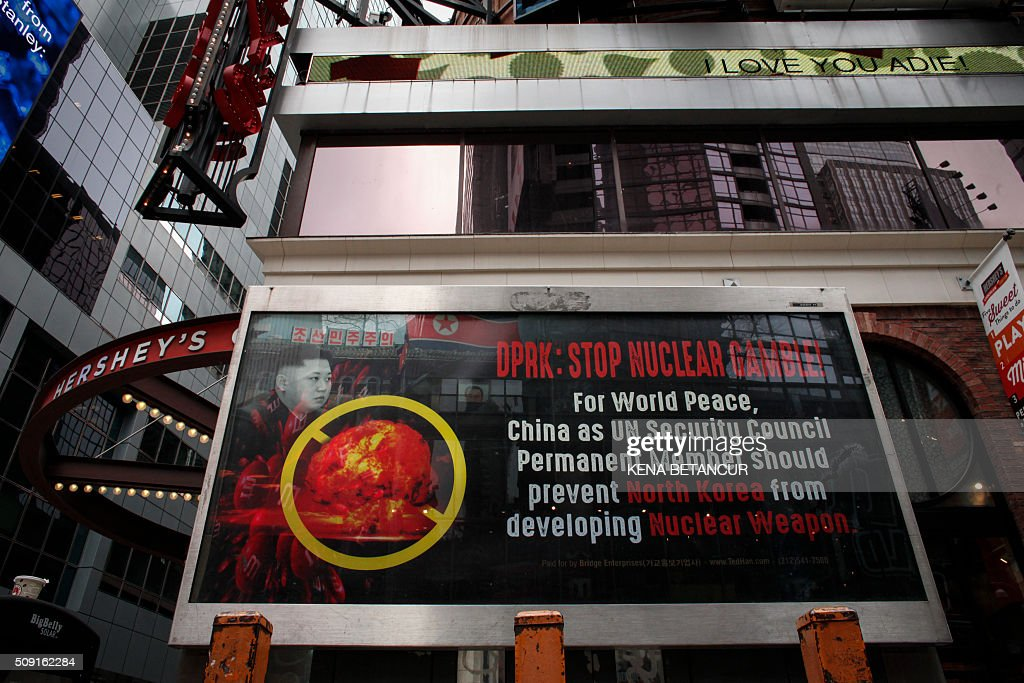 GAMBLE!' is displayed on a street near Times Square in New York on February 9,2016. The ad has put up by Ted Han, head of Bridge Enterprises, a Korean-American businessman. The UN Security Council strongly condemned North Korea's rocket launch on February 7, 2016 and agreed to move quickly to impose new sanctions that will punish Pyongyang for 'these dangerous and serious violations.' / AFP / KENA BETANCUR