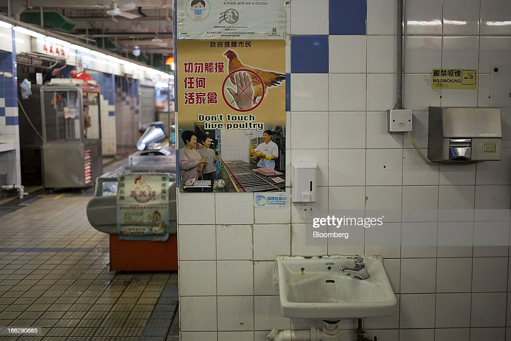 A poster about live poultry issued by Hong Kong's Food and Environmental Hygiene Department is displayed above a hand basin at the Kowloon City Market in Hong Kong, China, on Thursday, April 11, 2013. The Hang Seng Index rose 0.8 percent to 22,220.65 as of 1:14 p.m. in Hong Kong, headed for its longest winning streak since March 27. The gauge is close to erasing last week's loss prompted by the outbreak of a new strain of bird flu in China. Photographer: Jerome Favre/Bloomberg via Getty Images