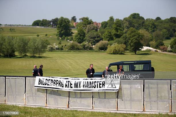A poster adorns the security barrier of the protester encampment outside The Grove hotel which is hosting the annual Bilderberg conference on June 6...